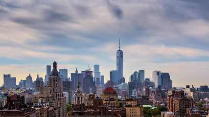 Fototapete - Beautiful clouds over New York City Manhattan skyline. NYC, NY. 4K Timelapse