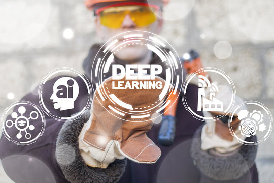 Industrial worker presses deep learning text button on a virtual interface. Deep Learning Computing Machine Analytics Artificial Intelligence Industry 4.0 concept.
