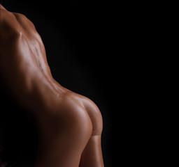 beautiful sporty female ass on a dark background