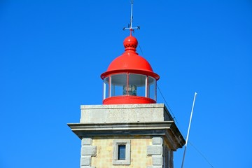 Top part of the lighthouse with its red painted top, Ponta da Piedade, Algarve, Portugal.