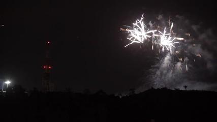 Fotobehang - Fireworks display over Hollywood Hills in Los Angeles California. Timelapse view