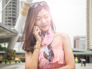 Asian beautiful girl talking on the phone.