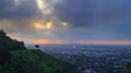 Fotobehang - Sunrise storm clouds rolling over city of Los Angeles cityscape 4K UHD timelapse