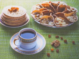 Arab pancakes with black coffee. Sweet food in Ramadan.