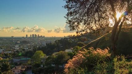 Klistermärke - Los Angeles cityscape view Hollywood Hills at sunset. 4K UHD rotating timelapse