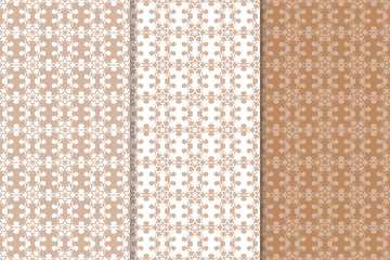 Brown floral ornaments. Set of seamless backgrounds