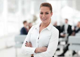 portrait of confident business woman on the background of the office.