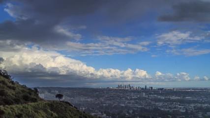 Fotobehang - Rain passing over city Los Angeles change sunny skyline beautiful double rainbow