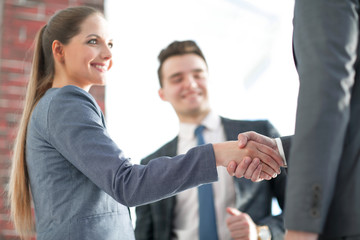 closeup of a business handshake partners.