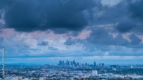Fotobehang Storm clouds over city of Los Angeles skyline twilight night. 4K UHD timelapse.
