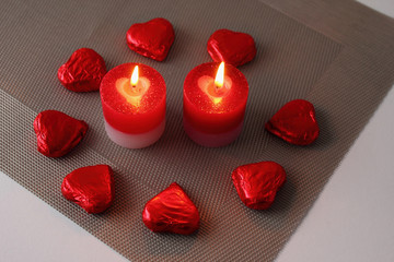Two candle with sweet hearts
