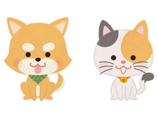 おすわりするペットの犬と猫