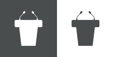 Icono plano atril con microfonos en gris y blanco