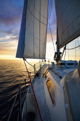 View from the deck of a yacht sailing in calm baltic sea at th evening