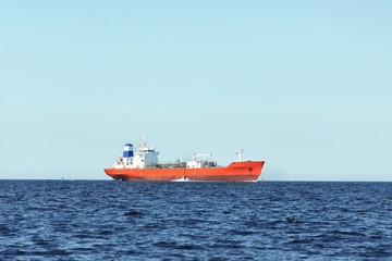 View of a red lpg tanker sailing in a open sea on a clear day