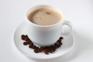 Cappuccino, coffee beans on white background