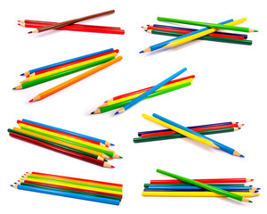Set of eight groups of colored pencils isolated on white background. Back to School. Stationery. Drawing.