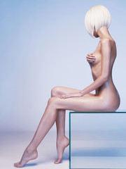 Nude sensual woman with fashionable hairstyle. Beautiful naked lady.