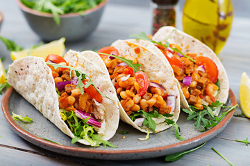 Mexican tacos with beef, beans in tomato sauce and salsa Wall mural