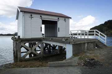 Ti Point Bay New Zealand. Boatshed at pier