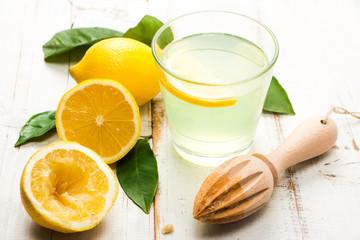Homemade lemonade on white wooden table