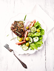 Pork Steak with Salad on a Plate