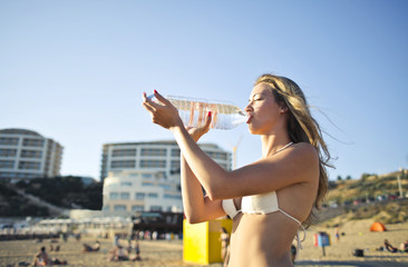 Thirsty girl at the beach