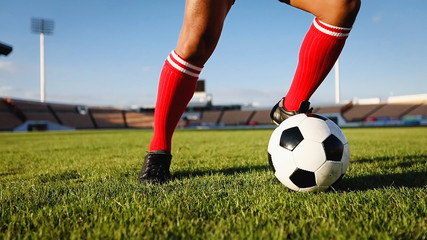 soccer or football player standing with ball on the field for Kick the soccer ball at football stadium