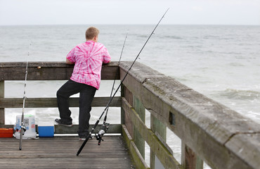 A youth looks on from the St. Johns County Pier before fishing in St. Augustine