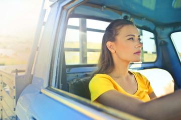 Beauty driving a truck