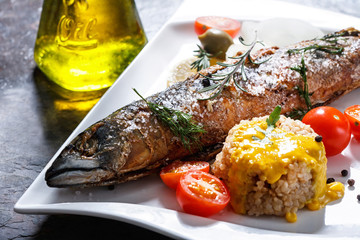 freshly grilled fish with vegetables and rice