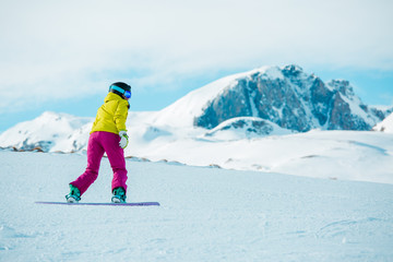 Picture of woman snowboarding on snowy slope