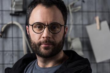 portrait of caucasian man in glasses  looking at camera