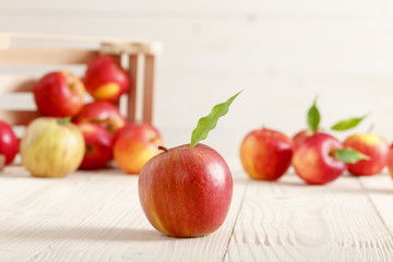 Red apples in a light wooden box