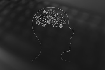 person's profile with gearwheel thought mechanism brain