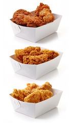 Fried breaded chicken fillet in white cardboard boxes