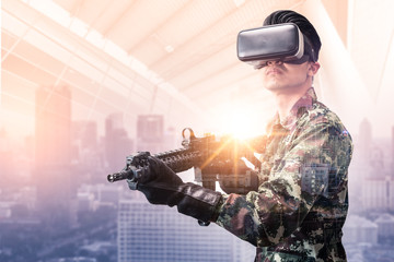 The double exposure image of the soldier hold a rifle during sunrise overlay with cityscape image. the concept of virtual hologram, simulation, gaming, internet of things and future life.