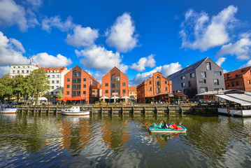 Klaipeda, Lithuania - August 18, 2017: Beautiful view on tourist boat, Dane river, embankment and red brick houses Klaipeda, Lithuania. Summer view on Dane river.