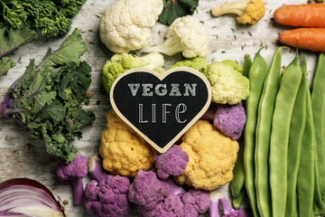 raw vegetables and text vegan life