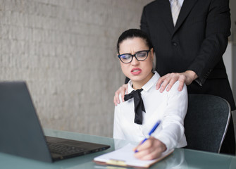 Boss touching employee on shoulder, sexual harassment