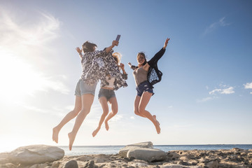 Three young woman jump for happiness. beauty and fun.