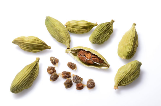 Cardamom pods and cardamom seeds isolate on white background
