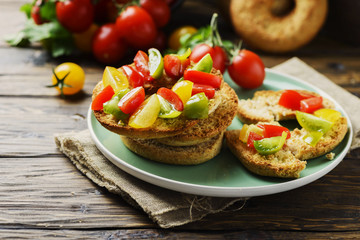Traditional italian bread frisella with tomatos
