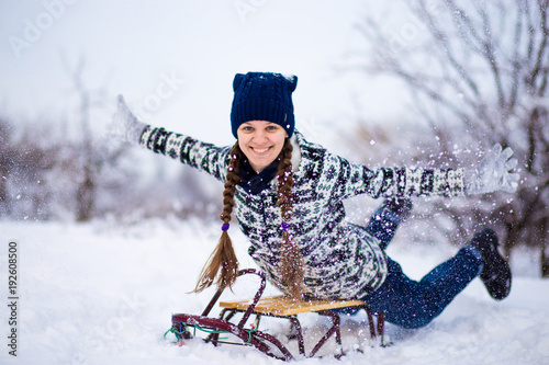 woman sledding funny woman play outdoors in snow - Christmas Vacation Sled