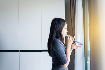 Patient woman using incentivespirometer or three balls for stimulate lung