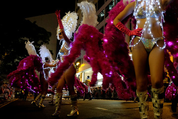 Members of Parisian Street Cabaret from France perform during a parade to celebrate the Year of the Dog in Hong Kong