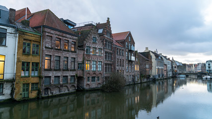 Picturesque medieval buildings on Leie river in Ghent town, Belgium, Europe.