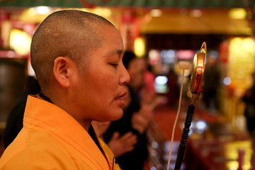 A monk chants and rings a bell at the Mahayana Buddhist Temple to welcome in the Chinese Lunar New Year in Manhattan's Chinatown in New York