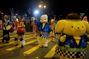 Sanrio characters from Japan perform during a parade to celebrate the Year of the Dog in Hong Kong