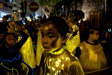 Young performers take part in a parade to celebrate the Year of the Dog in Hong Kong